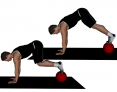 Prone Knee Tucks with Feet on Medicine Ball