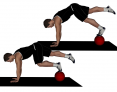 Prone Knee Tucks on Medicine Ball with Single Leg Extension